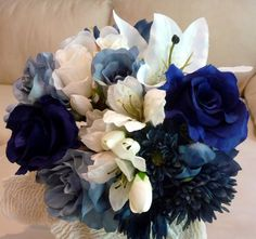 A handtied Bridal Bouquet in Shades of Blues and Wedding White.  Finished with a Blue Satin stem wrap.  Call for pricing.                    *** THIS IS SILK***                SAVANNAH EVENT DECOR