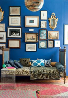 Antique gallery wall on a blue background