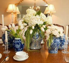 Kravets fabrics in blue and white for the pillows work perfectly with this traditional living room. The Chinese vases alway.