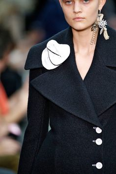Celine. Paris Fashion week.  2 Trends - Floral & single earring...