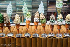 row of japanese ice cream on cones