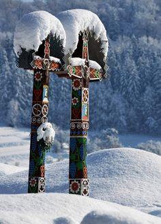 The Detva Cross is a decorated regional cross that can be seen in the Podpoľanie Region, as well as The Symbolic Cemetery in High Tatras of Slovakia. The symbolic cemetery (1525 m above the sea) is situated close to the Popradské Mountain Lake. It was built as a memorial to people who worked and tragically died in the High Tatras. Currently there are over 160 memorial-boards and 50 hand-carved wooden crosses.