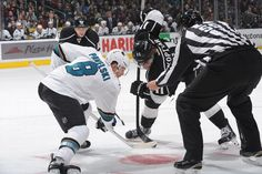 San Jose Sharks forward Joe Pavelski prepares for a faceoff against Los Angeles Kings forward Anze Kopitar (Dec. 27, 2014).