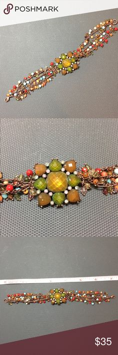 Fashion jewel & beaded bracelet Pretty fashion bracelet with jewels and rhinestones in green and orange muted colors. Has 3 strands of beads on bracelet. Bronze color with earth toned jewels and beads.  Approximately 7.25 inches. 21.7 grams. 🚫 Trades. 🚫 Lowball Offers. Please ask questions prior to purchase. Jewelry Bracelets
