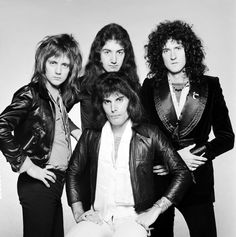 British rock band Queen, circa 1975. Clockwise from front, singer Freddie Mercury (1946 – 1991), drummer Roger Taylor, bassist John Deacon and guitarist Brian May. (Photo by Terry O'Nei…