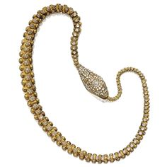 GOLD AND DIAMOND SERPENT NECKLACE, MID-19TH CENTURY Designed as a long, articulated serpent, its open jaws clasping the end of its tail, decorated in the center of the head with an old-mine cushion-shaped diamond weighing approximately 4.00 carats, bordered by clusters of smaller old-mine and single-cut diamonds,  the tapering body decorated with circular motifs pavé-set with diamonds as well as with collet-set old-mine diamonds, length 32 inches; together with an additional link
