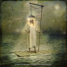 Trevillion Images - surreal-image-of-woman-on-raft-in-sea