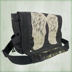 Daryl Dixon Wings Messenger Bag http://shopthewalkingdead.com/daryl-dixon-wings-messenger-bag/details/32815842?cid=social-pinterest-m2social-product&current_country=US&ref=share&utm_campaign=m2social&utm_content=product&utm_medium=social&utm_source=pinterest $89.95