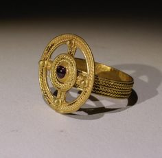 LOVELY QUALITY ANCIENT ROMAN SOLID GOLD, 22-24KT RING, HAVING A LARGE CIRCULAR BEZEL IN THE FORM OF A CROSS, INSET WITH A FINE GARNET CABOCHON. DATING CIRCA 5TH CENTURY AD. FROM AN OLD COLLECTION BY DESCENT. | eBay!