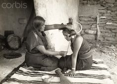 Hopi maiden's hair is coiled in preparation for a snake dance