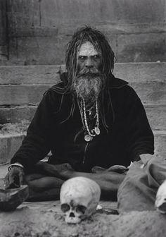 An Aghori man with a human skull, 1897.