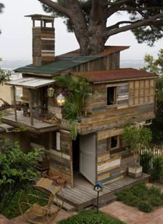 Playhouse / Treehouse of reclaimed wood! #LiquidGoldSalvagedWood..... same concept, but smaller scale...maybe use pallet wood from home build?