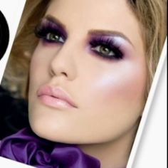Dramatic makeup, smokey purple eyes and nude lips