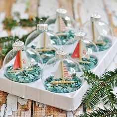 DIY Christmas Ornaments | Nautical or nice? This holiday season, learn to make these adorable sailboat ornaments by Kim at Sand and Sisal-- a perfect gift for any seafaring enthusiast!