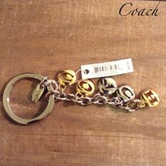 Gold & Silver Coach Key Chain Gold & Silver NWT New chain that letters spell COACH. It's just too cute not to buy! Coach Accessories Key & Card Holders