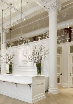 White industrial ceiling, nice cabinetry, doors. and floors.