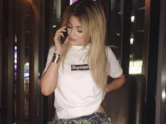 Kylie Jenner is killing it, in the supreme bogo in white and black. This t-shirt is the most iconic t-shirt from supreme.