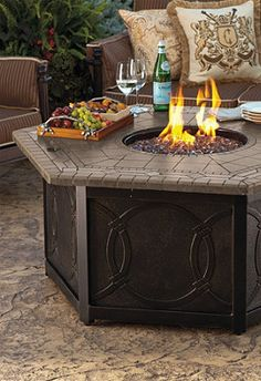 Warm your outdoor conversation area with flickering firelight.