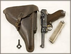 WWII German Luger pistol, made by Mauser, code S/42, dated 1936 - Brown leather holster, spare magazine and loading/takedown tool. The Luger fired a 9mm round although other calibres were made.