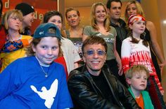 Robin Gibb poses with kids and singers at the taping of the German television special 'An Evening For Peace'...