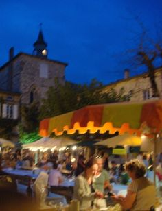 Thursday evening market in the central square of Monflaquin in Aquitaine, France in August.