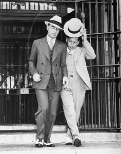 """Owney Madden (left), New York's Public Enemy No. 2 as a gang leader in New York's Hell's Kitchen (the """"Westies""""), leaves the gates of Sing Sing Prison, Ossining, after spending a year behind bars for violation of parole on a manslaughter sentence. Madden has two more years on parole. Date Photographed: July 7, 1933"""