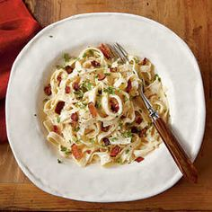 How to Cook Fettuccine Alfredo with Bacon | Treat yourself tonight! Indulge in this lightened version of the rich Italian pasta dish.