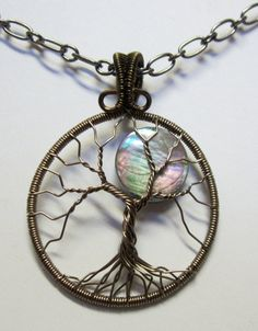 A Brilliant Full Moon Tree of Life Pendant by Mariesinspiredwire, $38.00 - love the bale on this.
