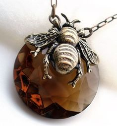 """""""Queen Honey Bee"""" Exclusive design by Federikas. This enchanting bee encases a large and rare topaz Czechoslovakian glass jewel."""