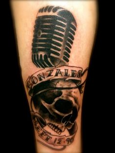 Microphone and skull tattoo done by Angela Grace