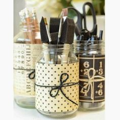 Simple, beautiful storage: recycled jars plus scrapbook paper accents for a craft room