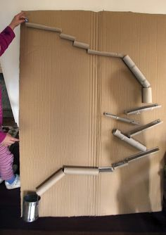 Cardboard tube marble run - My students make these (with a few twists) when studying Newton's Laws of Motion.