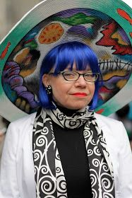 Elaine Norman wearing one of her handpainted hats.