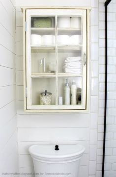 Bathroom storage cabinet using an old window.  Could also be a fun display case in an entryway or hall for memorabilia ... or change it out regularly with seasonal items.