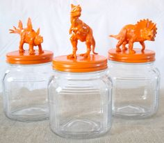 Adhere plastic toys to jar lid + Spray paint jar lid & plastic toy = fun storage containers.