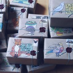 Hand-painted brown paper packages with illustrations inspired by the recipients, or their names or addresses.