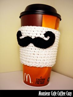 Monsieur Cafe Coffee Cozy Crochet Pattern - this is so cute. What a cute idea, crocheting cup holders. sweaters for your coffee while protecting your hands. This is famazing to the max! Crochet Coffee Cozy, Crochet Cozy, Crochet Crafts, Yarn Crafts, Crochet Projects, Coffee Cozy Pattern, Rainbow Loom Charms, Rainbow Loom Bracelets, Rainbow Loom Creations