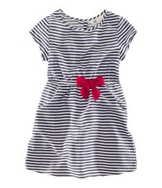 H Woven dress with cap sleeves and an applique detail at front, elasticized waist, two side pockets, and buttons at back of neck. $12.95