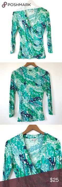 "CAbi Green Faux Wrap Print Knit Top Style#966 M Bust: 18"" Length: 25""  Condition: No Rips; No Stains  94% Rayon 6% Spandex   📦Orders are shipped within 24hrs! {Except weekends}📦  🚫No Trades🚫No Holds🚫 CAbi Tops Blouses"