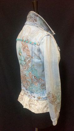 Hand painted up-cycled denim jacket.