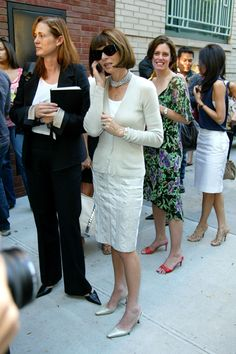 Anna Wintour wears a cardigan, cream skirt and slingback kitten heels
