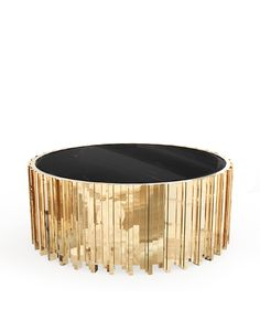 Empire Center Table   LUXXU Modern Lamps   This center table has an extravagant shape of refinement and style. #modernlamps #modernchandelier #luxurychandelier See more: http://www.luxxu.net/products/empire-center-table.php