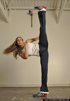 I believe this is Stacey Nemour, highly respected martial artist. Excellent flexibility in a side kick.  www.thedojofc.com