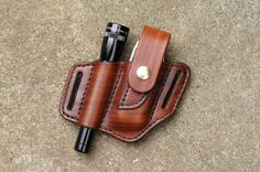 Always have your favorite multitool and flashlight close at your side with this handcrafted belt sheath for your Leatherman Wave or Charge and Mini Maglite. Made from thick, top quality vegetable tanned cowhide, this case is carefully hand molded for a perfect and secure fit. The edges have been hand dressed and burnished for a classic look. Built to last a lifetime, the look and feel of the leather will only improve with age as it takes on your character and personality through use. Brown…