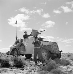 A South African Marmon-Herrington armoured car crew stops to take a compass bearing during a patrol. The South African armoured car units were successfully used in North Africa for reconnaissance duties and as part of mobile columns despatched to harrass the enemy.