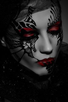 Creative dark makeup idea - like the red and black together and the idea of black designs over the whole face
