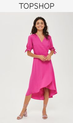 Bright magenta pink and figure-flattering, this elegant wrap dress is party-ready. Featuring short tie sleeves and an asymmetric hem, this floaty number is perfect for partnering with strappy heels.