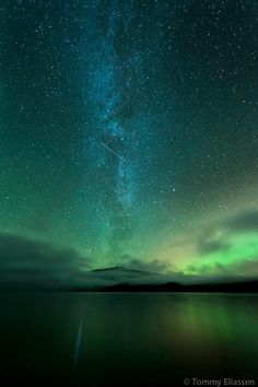 The milky way, aurora and a satellite over Hemnes, Norway on September 24th, 2012.  Nikon D700, 14-24mm.