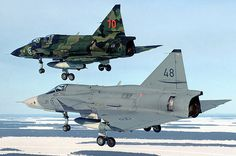 Two Saab Viggen fighters in different color schemes