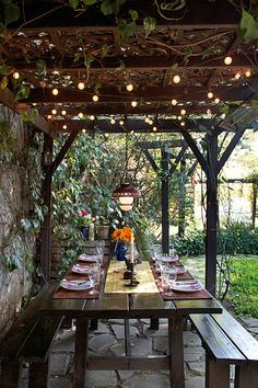 small space dining: flagstone paving, vine-covered arbor, and romantic lighting